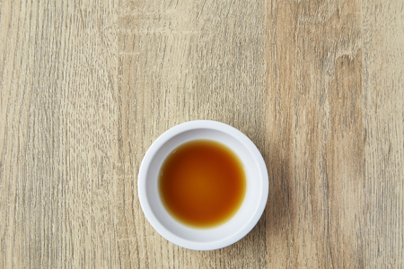 Japanese Soy sauce on wooden table, Top view with copy space and text Banque d'images