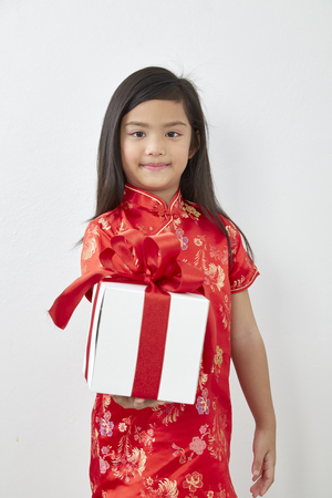 Chinese Girl eight year old girl with Chinese New Year 2019 With gift box on white Stock Photo