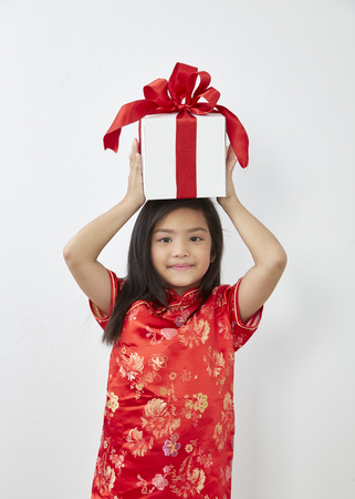 Chinese Girl eight year old girl with Chinese New Year 2019 With gift box on white backgrond, Concept New Year Sale Stock Photo