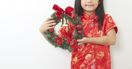 Asian girl with Christmas wreath and Chinese New Year 2019, For the holiday background design. Stock Photo