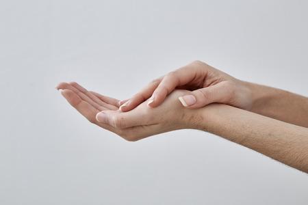 Empty Female hand holding isolated on white background
