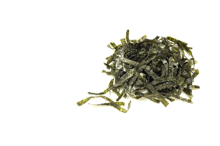 Seal of dried seaweed in a white  on a white table. Light emulates natural light with space for design. 스톡 콘텐츠