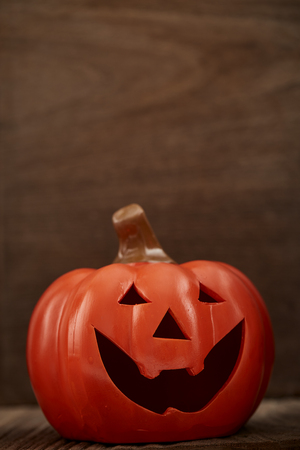 Autumn still life with a pumpkin on wooden background Stock Photo