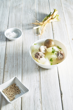 Famous Homemade Fresh Pickled Lemon Soup with pork and Winter Melon on white wood table with empty space for writing your own message, Natural light Reklamní fotografie