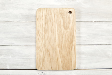 Cutting board top view on wooden white wooden with copy space, Empty space for design, 免版税图像 - 111287125
