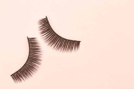 Eyelashes are on pink background soft selective focus. Empty space for design