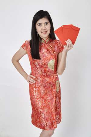 Beauty Chinese woman wear cheongsam and take Red envelopes chinese new year 2019, Concept of happy chinese new year