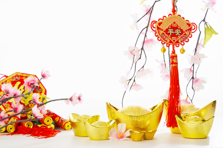 Chinese New Year Decorations Traditional Handicraft gold ingot and firecrackers and Plum Tree on empty white background for business promote and Chinese alphabet meaning of rich and goodluck.