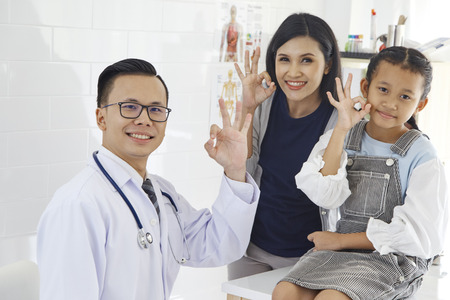 Doctor with medical clinic background for nursing care professional and patient trust in hospital's hospitality concept, Mother and Asian daughter come to the doctor. Imagens