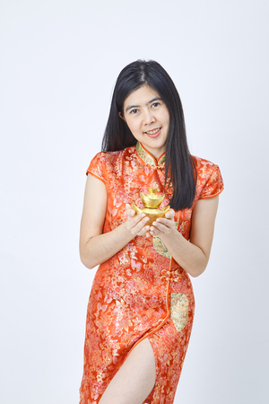 Beauty woman wear cheongsam and smile to you in chinese new year 2019 on white background, Promotion concept trade Business Banco de Imagens