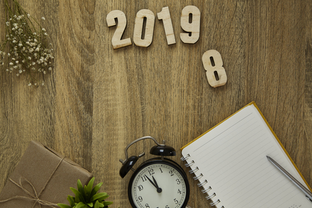 Work goal concept New Year 2019 Background workspace frame on wooden background .flat lay