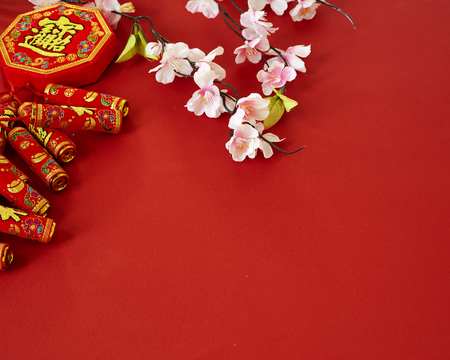 chinese new year 2019 festival decorations plum flowers on red  background (Chinese characters . in the article refer to good luck, wealth, money flow) Empty space for design Stockfoto
