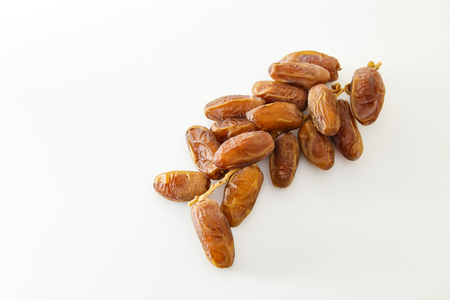 Creative Dried dates on stalk white background. Flat lay. Food concept.