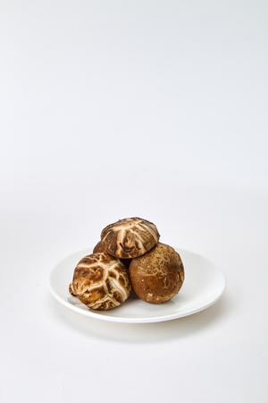 Fresh shiitake mushroom isolated on white background Tonic components