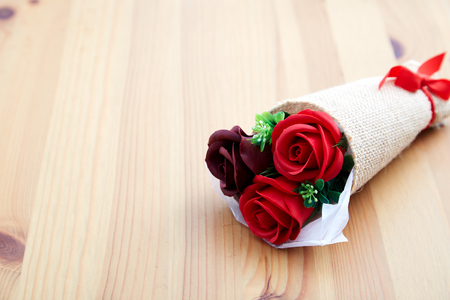 A couple gift roses on valentine day on wooden table in the kitchen, empty space for design Reklamní fotografie