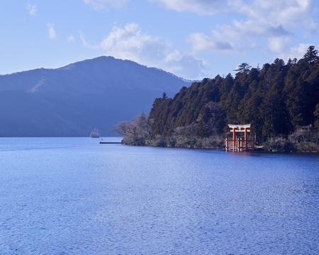 Mount Fuji and a big red Torii (Gate to the Hakone Shrine) on the Ashinoko Lake Under the sky In the bright winter. Kanagawa  in Hakone, Japan.