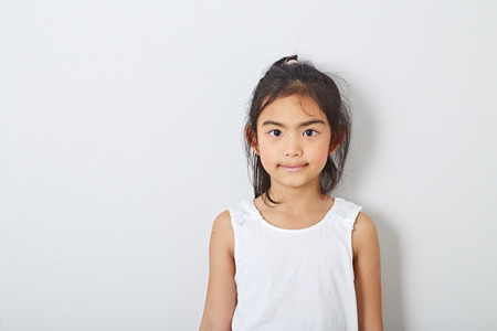 9 year old girl Portrait of Asian girl children smiling at room the bright gray wall smiling inspiration concept ideas, Fashion, education and health Imagens