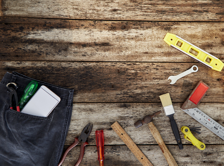 Fathers day or Labour day background concept - hammer many handy working tools on wooden rustic background. top view And empty space for design Reklamní fotografie