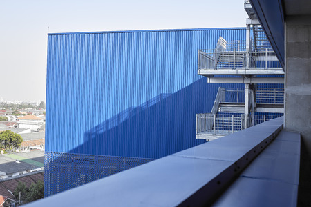 Abstract view of modern building with stairs, Blue factory structure Imagens - 118558417