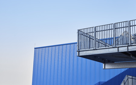 Abstract view of modern building with stairs, Blue factory structure Imagens - 118558419