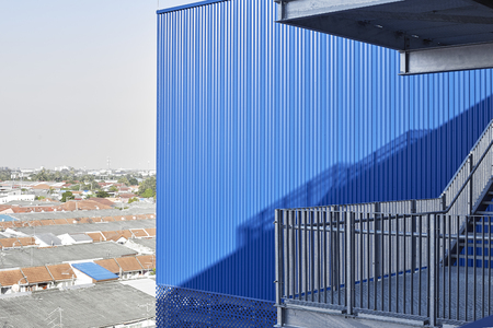 Abstract view of modern building with stairs, Blue factory structure Imagens - 118558420