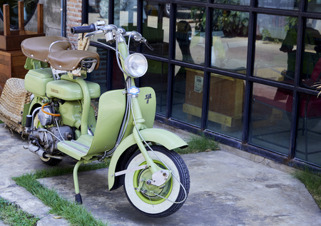 Vintage Italian green scooter of the Lambretta 125 in classic cars and motorcycle rally - auto moto raduno in Kanchanaburi, Thailand: Mar ,01, 2019 Editorial