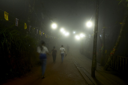 Chanthaburi, Thailand: Mar, 03,2019 , Foggy night People are worshiping the footprint in the rock on the top of Kitchakut Mountain Redactioneel
