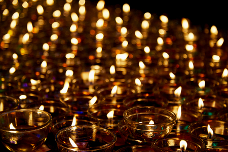 Fire in glasses Candlelight floating oil lamps illuminate belief that if people with oil lamps to illuminate life's