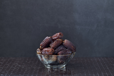 Ramadan kareem meaning Blessed ramadan with dates fruits on the dark wooden table and black background Stock Photo
