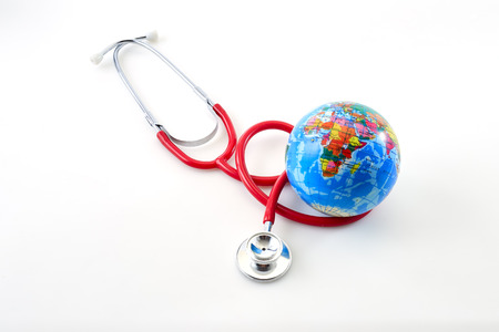 Red stethoscope with globe on white background. Copy space. Healthcare. World Health Day 7 April