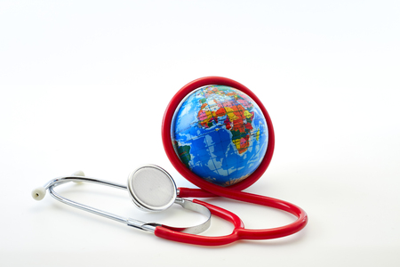 Red stethoscope with Empty calendar and globe on white background. Copy space. Healthcare. World Health Day 7 April