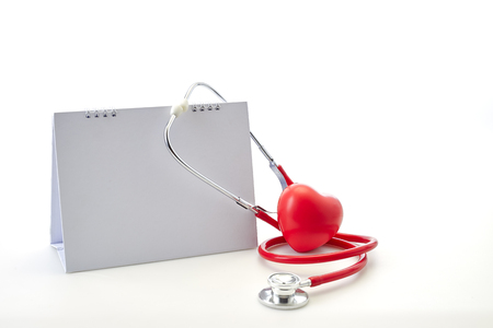 Flat 7 April Red stethoscope with empty calendar and heart shape on white background. Copy space. Healthcare. World Health Day Banco de Imagens