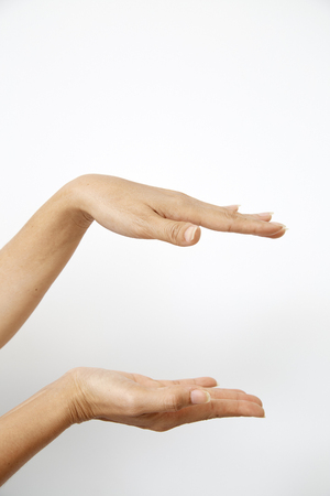 Hand woman's holding something palm making gesture while showing small amount of something on white isolated background, side view, close-up, cutout, copy space Banco de Imagens
