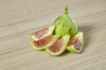 Healthy organic ripe sweet green figs on a wooden table, Healthy fruit