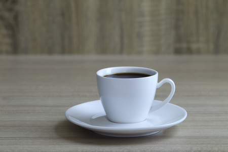 Minimal, Black coffee cup on wooden table with copy space