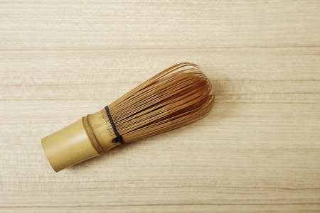 Bamboo tea whisk for matcha on wooden table background, traditional culture of Japanese matcha tea