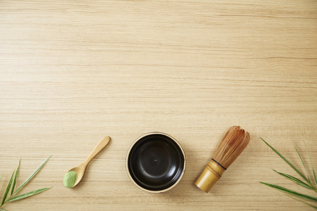 Flat-lay of Japanese tools for brewing organic matcha green tea, top view, copy space Imagens