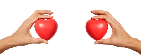 Hands holding red heart shaped for World Health Day or valentines day, on white background Imagens - 121133601