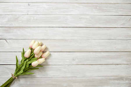 Pink tulips bouquet on a white wooden table, mothers day banner background, Empty space for design Stok Fotoğraf