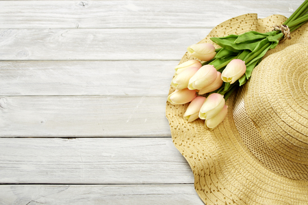 Spring or summer with tulips and hat on a white wooden table banner background, mothers day , Empty space for design Stok Fotoğraf