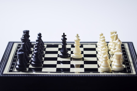 Chess board on the white background. Business success concept. Strategy. Checkmate Stok Fotoğraf