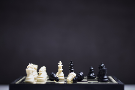 Chess board on the dark background. Business success concept. Strategy. Checkmate Stok Fotoğraf