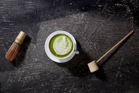 Matcha tea latte on black table black table. Top view. Place for text