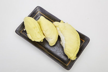 Ripe yellow flesh of Durian on black plate , Asia fruits, Thailand. Imagens