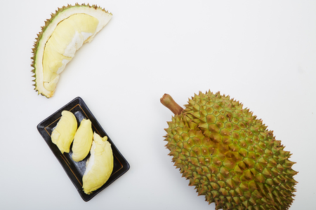 Fresh cut durian on white background, king of fruit from Thailand, creative food concept