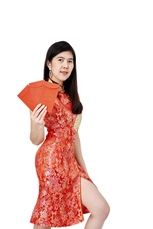 Asian pretty women in red cheongsam dress holding red envelope or ang pao on white background. is a primordial tradition of the Chinese people.