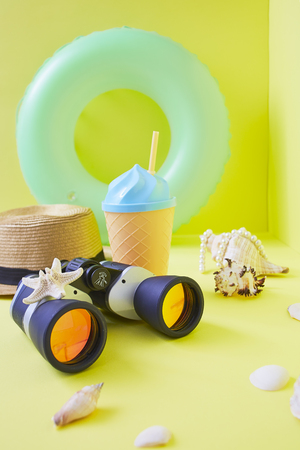 Travel plan concept, Composition traveler summer vacations accessories retro binoculars and starfish summertime on bright yellow wall background. copy space for banner