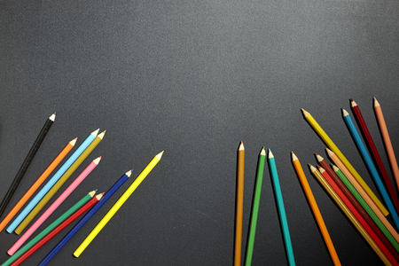 Top view back to school background Colorful pencils on a blackboard