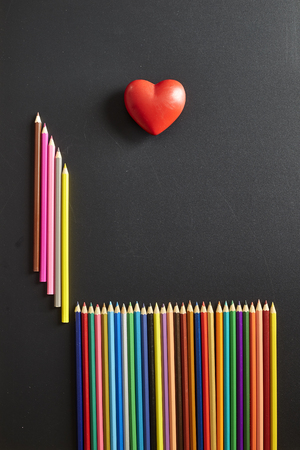 Concept Back to school banner blackboard Colorful pen and Red heart shape for adding text or design,education