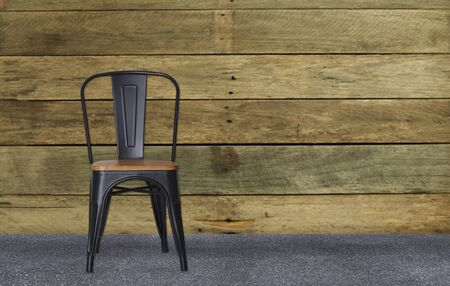 Modern black steel chair in wooden room interior concrete Copy space